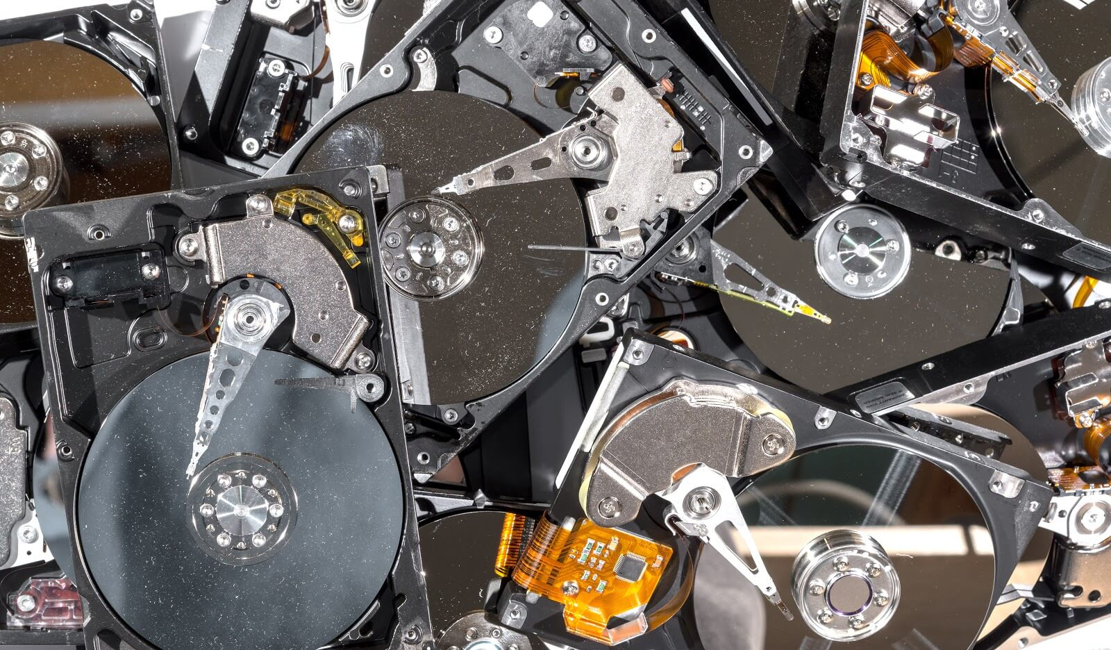 A pile of hard drives being recycle