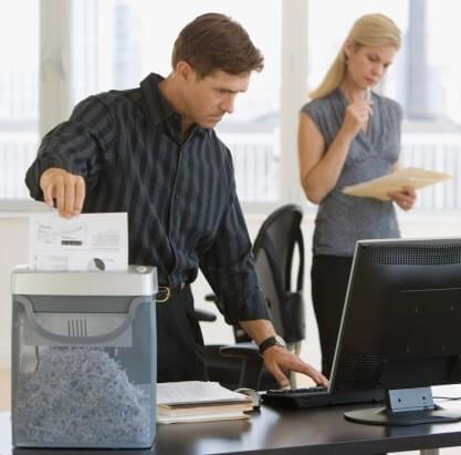 Businessman shredding paperwork